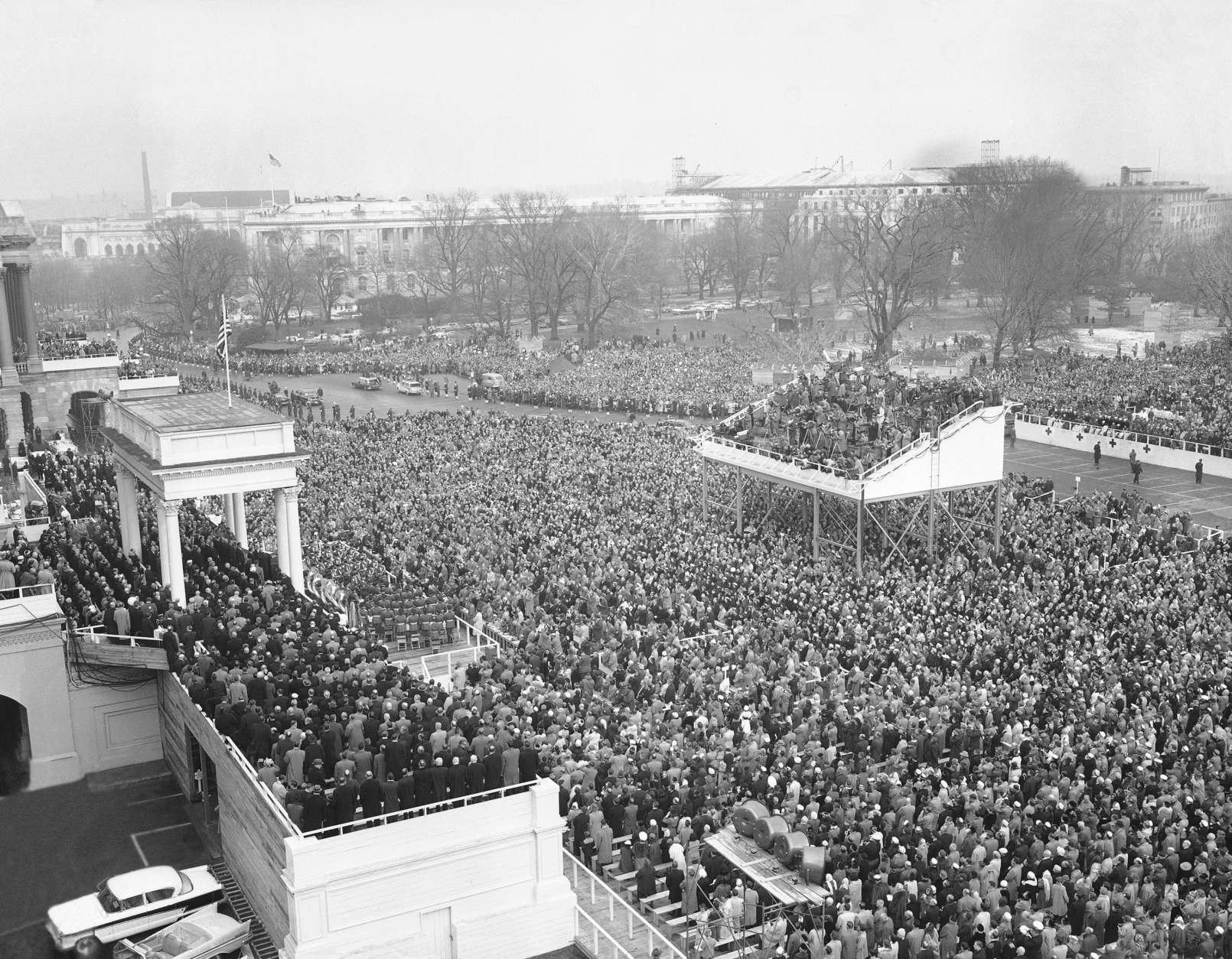 View from house roof during public ceremonies at Capitol in Washington, D.C., Jan. 21, 1957 as President Dwight Eisenhower and Vice President Richard Nixon were sworn in for second terms. Cameramen fill stand above crowd at right center. (AP Photo)