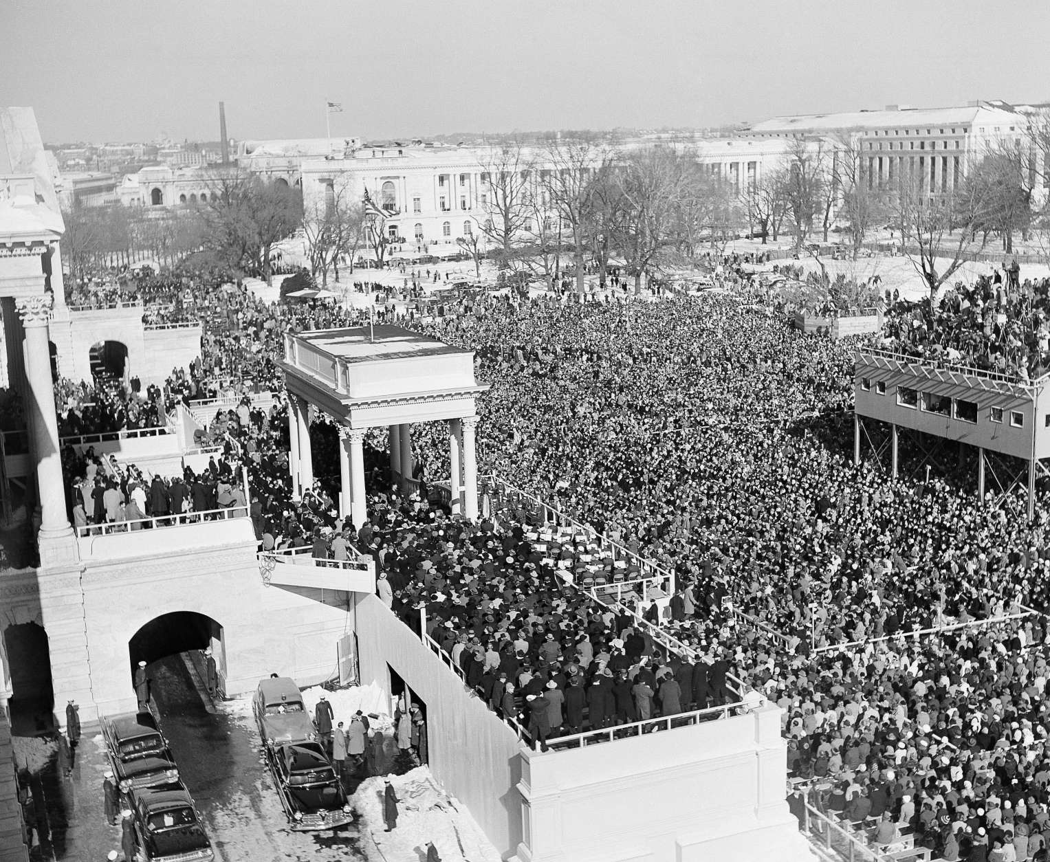 ** FILE ** In this Jan. 20, 1961 black-and-white file photo, shows a general view of the crowd in Capitol Plaza to witness the inauguration of John F. Kennedy as President of the United States.  President-elect Barack Obama's inauguration is expected to draw 1 million-plus to the capital, and already some lawmakers have stopped taking ticket requests and hotels have booked up. (AP Photo, File)