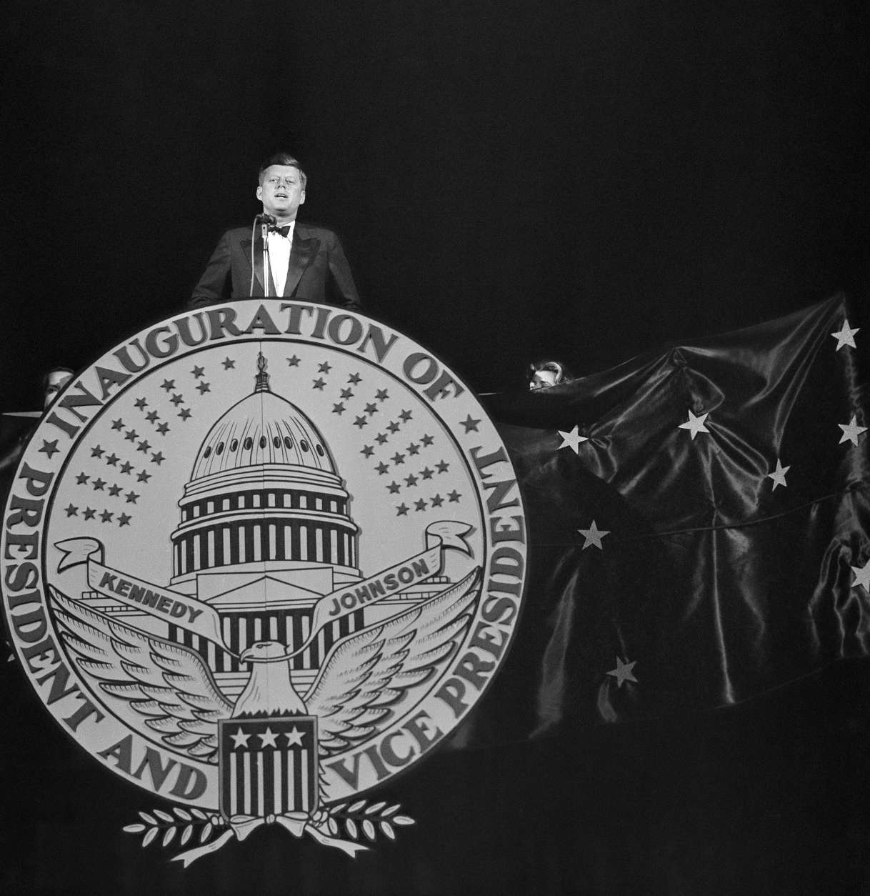 President-elect John F. Kennedy addresses the audience attending the Inaugural Gala performance on the eve of his inauguration in Washington, Jan. 19, 1961. The big show, with top stars of the entertainment world, was sponsored by the Democratic National Committee as a fund-raising event. A snowstorm which swept the city and paralyzed traffic, cut down on the anticipated attendance. (AP Photo/Hans Von Nolde)