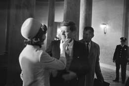 Mrs. Jacqueline Kennedy has a chuck under the chin for her husband moments after he became president, January 20, 1961. This exclusive picture by AP photographer Henry Burroughs was taken in the rotunda of the Capitol just after President John F. Kennedy left the inaugural stand.  (AP Photo/Henry Burroughs)