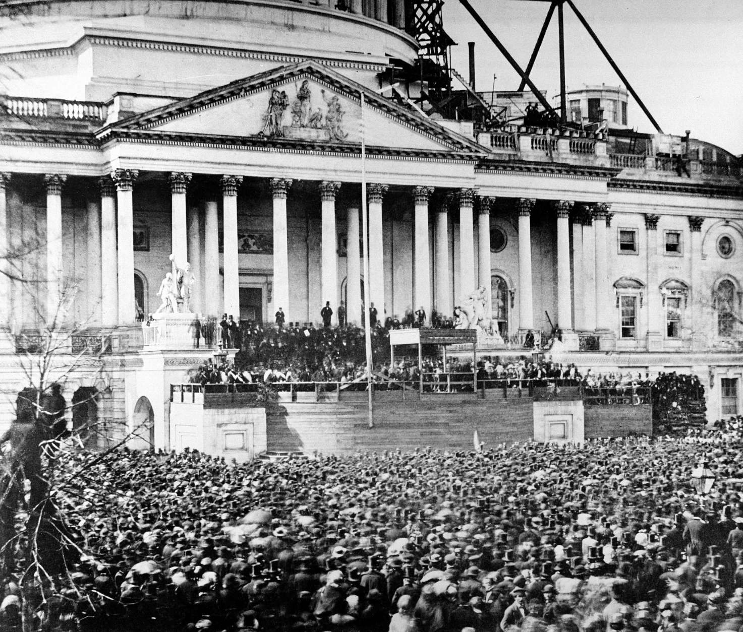 U.S. President Abraham Lincoln stands under cover at center of Capitol steps during his inauguration in Washington, D.C., on March 4, 1861.  The scaffolding at upper right is used in construction of the Capitol dome.  (AP Photo)
