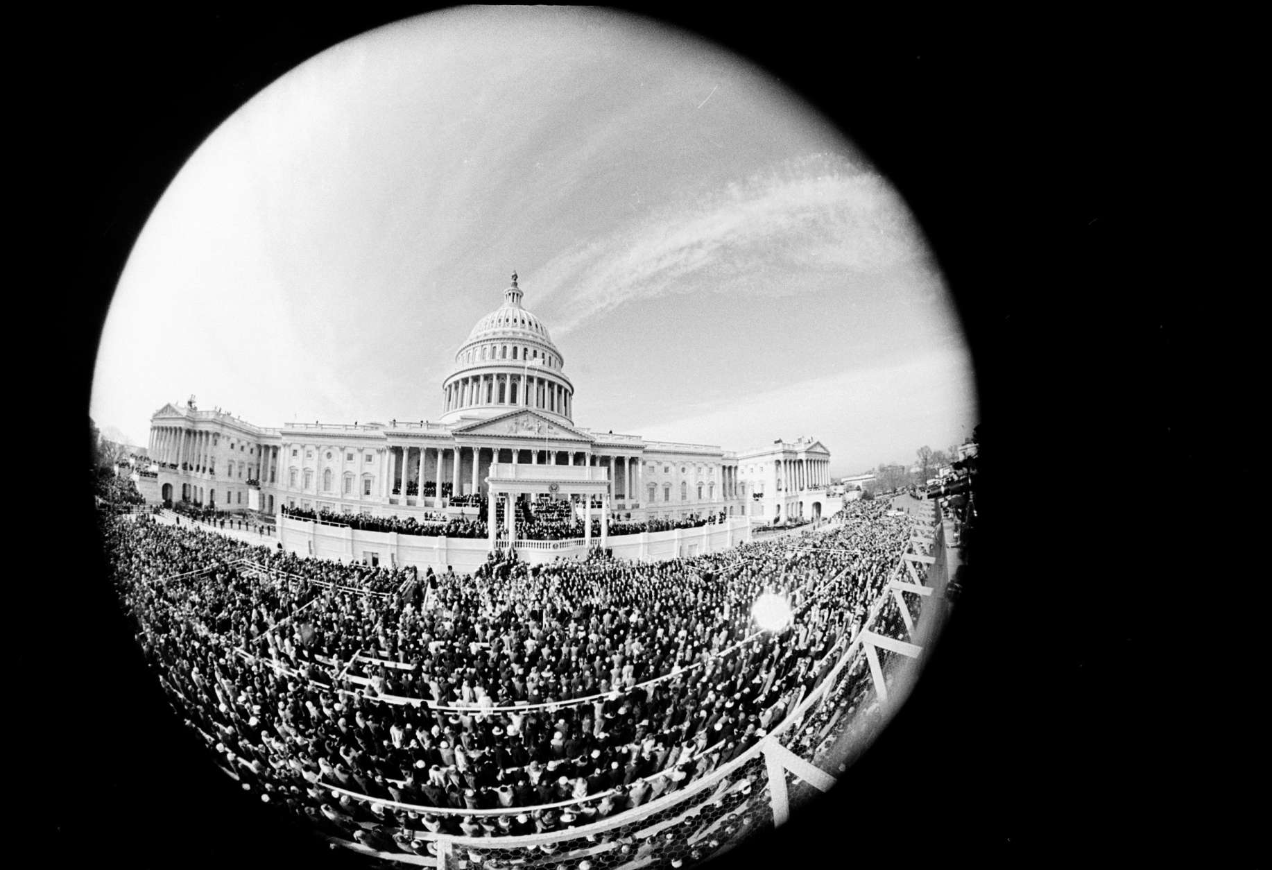 This fisheye view shows the inauguration day ceremony of President Lyndon B. Johnson as he is sworn in as the 36th president of the United States, Jan. 20, 1965.  (AP Photo)