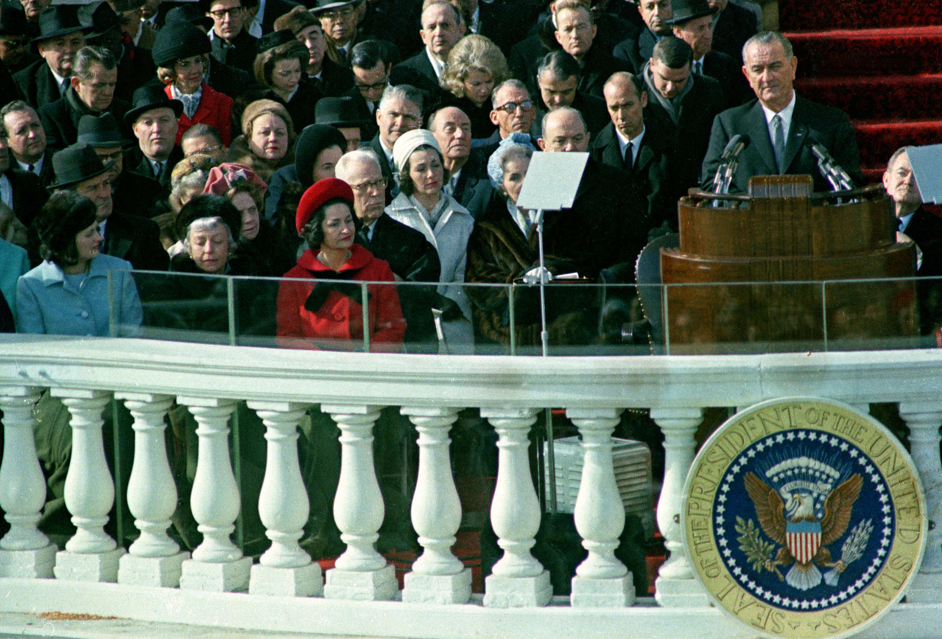U.S. President Lyndon B. Johnson delivers his inaugural address during inauguration ceremonies on the east portico of the Capitol building in Washington, D.C., Jan. 20, 1965.  Johnson was sworn in as the 36th president of the United States.  Visible in front row, left, is first lady Lady Bird Johnson, who held the bible as her husband took the oath of office, beginning a new tradition.  (AP Photo)