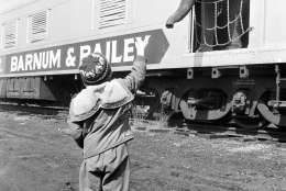 Brain Hayes, 5, greets one of the elephants that arrived aboard the circus train for a week stand in Philadelphia on March 29, 1966. (AP Photo/Warren M. Winterbottom)