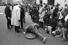 Secret Service and security forces check a manhole along the Pennsylvania Avenue parade route for any potential danger to the incoming and outgoing chief executive on Jan. 20, 1969 in Washington, in preparation for the inauguration of Richard M. Nixon. (AP Photo)
