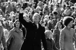 President Jimmy Carter waves to the crowd while walking with his wife Rosalynn along Pennsylvania Avenue and their daughter Amy.  The Carters elected to walk the parade route from the Capitol to the White House following his inauguration in Washington, on Thursday, Jan. 20, 1977. (AP Photo/Suzanne Vlamis)