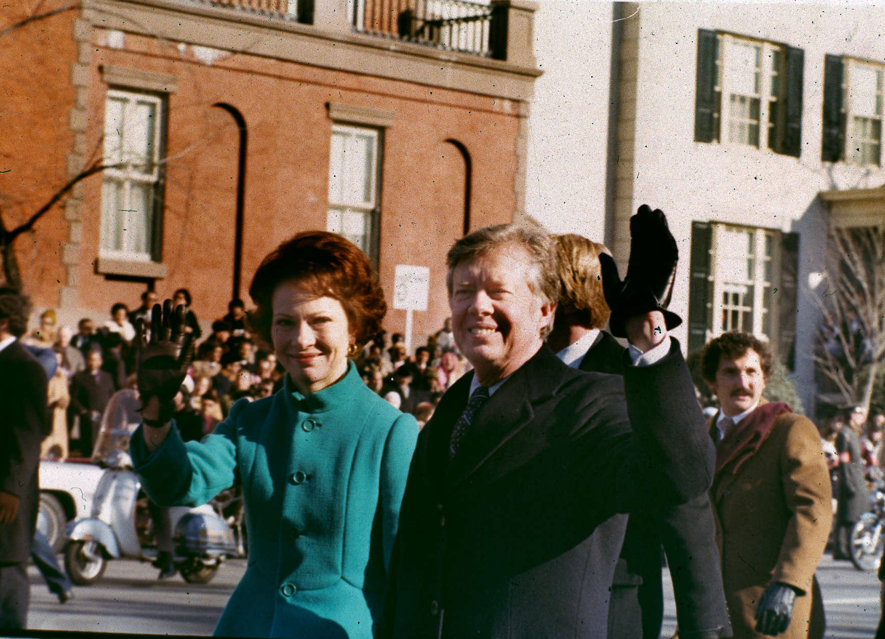 U.S. President Jimmy Carter, right, and his wife, first lady Rosalynn Carter, wave to the crowd as they walk down Washington's Pennsylvania Avenue, Jan. 20, 1977.  Carter was sworn in as the 39th president of the United States during the inauguration ceremonies.  (AP Photo)