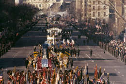 This is a general view of the Inaugural Parade proceeding down Washington's Pennsylvania Avenue with the Capitol building visible in the background, Jan. 20, 1977.  Jimmy Carter was sworn in as the 39th president of the United States during the inauguration ceremonies earlier.  (AP Photo)