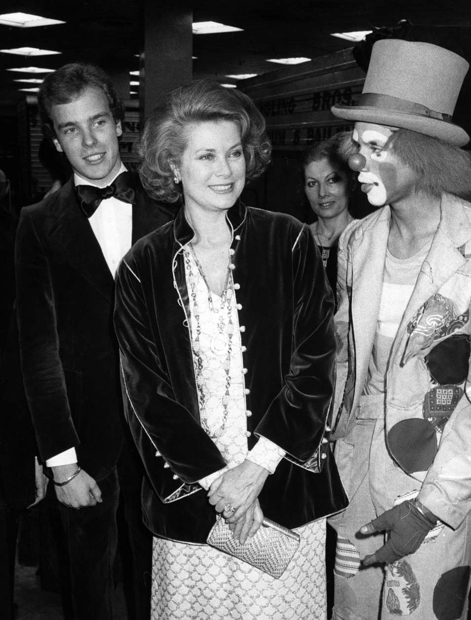 Princess Grace of Monaco, center, and her son Prince Albert, left, chat with clown Duanne Cunningham, Tuesday night, March 29, 1977, at New York's Madison Square Garden. The princess and her son came to watch the opening night performance of the 17th edition of Ringling Bros. and Barium & Dailey Circus. (AP Photo)