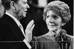 Nancy Reagan proudly watches as her husband Ronald Reagan takes the oath of office at the Capitol January 20, 1981.  (AP Photo)
