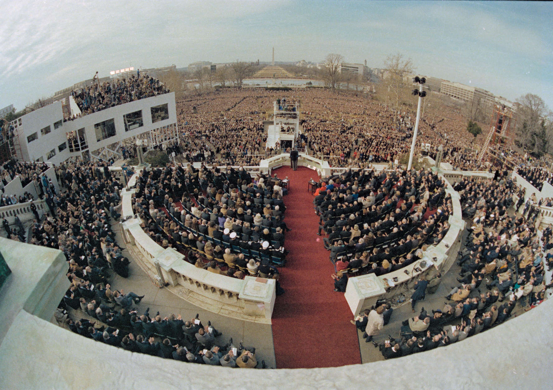 ** FILE ** In this Jan. 20, 1981 file photo, shows a wide angle view from the Capitol balcony as President Ronald Reagan, visible at center, addresses the nation following his swearing-in ceremony in Washington.  President-elect Barack Obama's inauguration is expected to draw 1 million-plus to the capital, and already some lawmakers have stopped taking ticket requests and hotels have booked up.  (AP Photo, File)