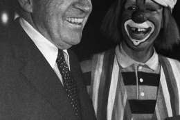 "Former President Richard Nixon shares a laugh with ""Sam"" the clown from the Ringling Brothers and Barnum and Bailey Circus, at the Brendan Byrne Arena on Nov. 26, 1982 in East Rutherford, New Jersey. Nixon was at the circus with his grandchildren. (AP Photo/David Bookstaver)"