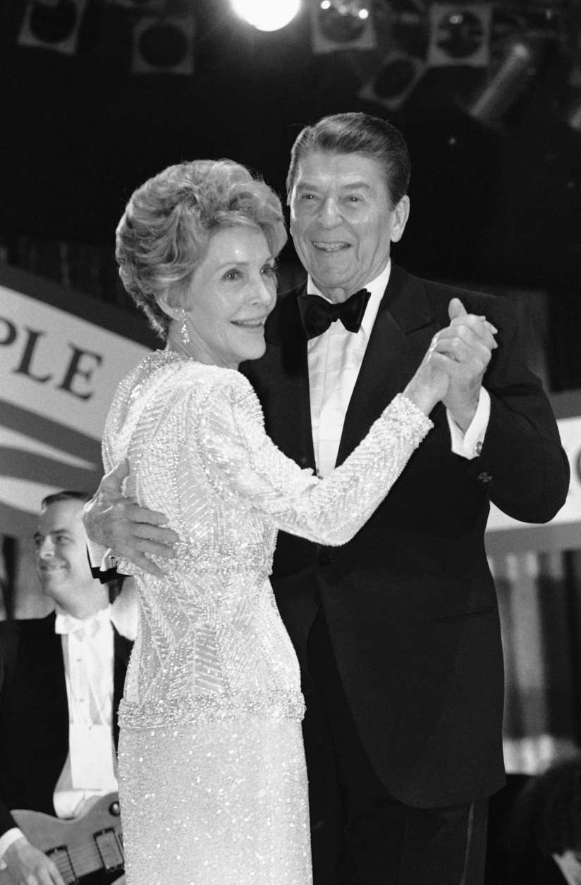 President Reagan and Mrs. Reagan have the first dance at the Inaugural Ball for Young Americans at the D.C. Armory at night on Monday, Jan. 21, 1985 in Washington. (AP Photo/Ira Schrawz)