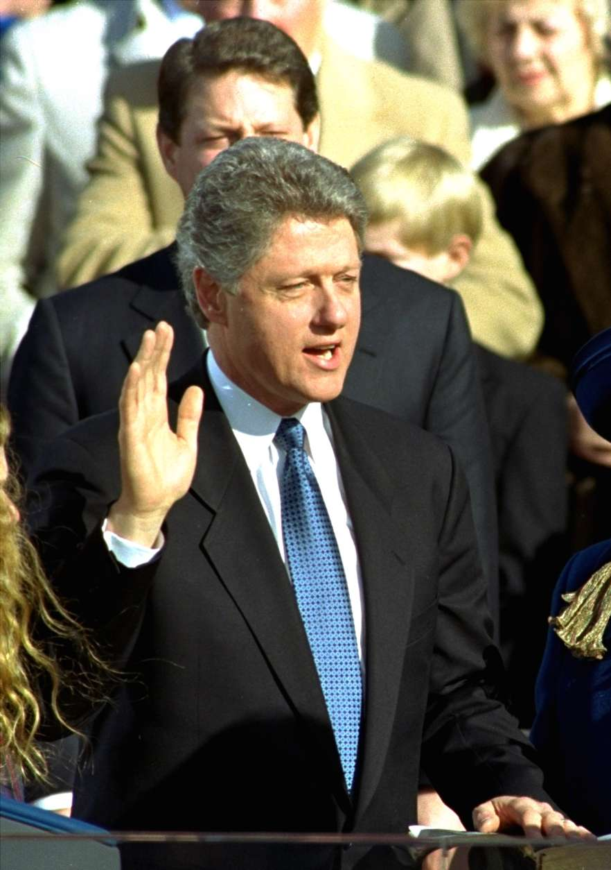 Bill Clinton takes the presidential oath of office during the inaugural ceremony on Capitol Hill Wednesday, January 20, 1993.  Vice President Al Gore is behind Clinton.  Clinton became the 42nd president of the United States.  (AP Photo/Ed Reinke)