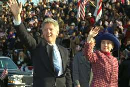 President and Mrs. Clinton wave as they walk down Pennsylvania Avenue in Washington Wednesday, January 20, 1993 during the presidential inaugural parade.  (AP Photo/Doug Mills)