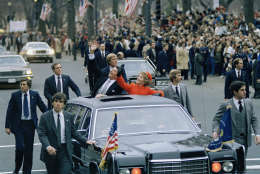 President Ronald Reagan and first lady Nancy Reagan wave from their limousine during the inaugural parade in Washington, D.C., Jan. 20, 1981. (AP Photo)