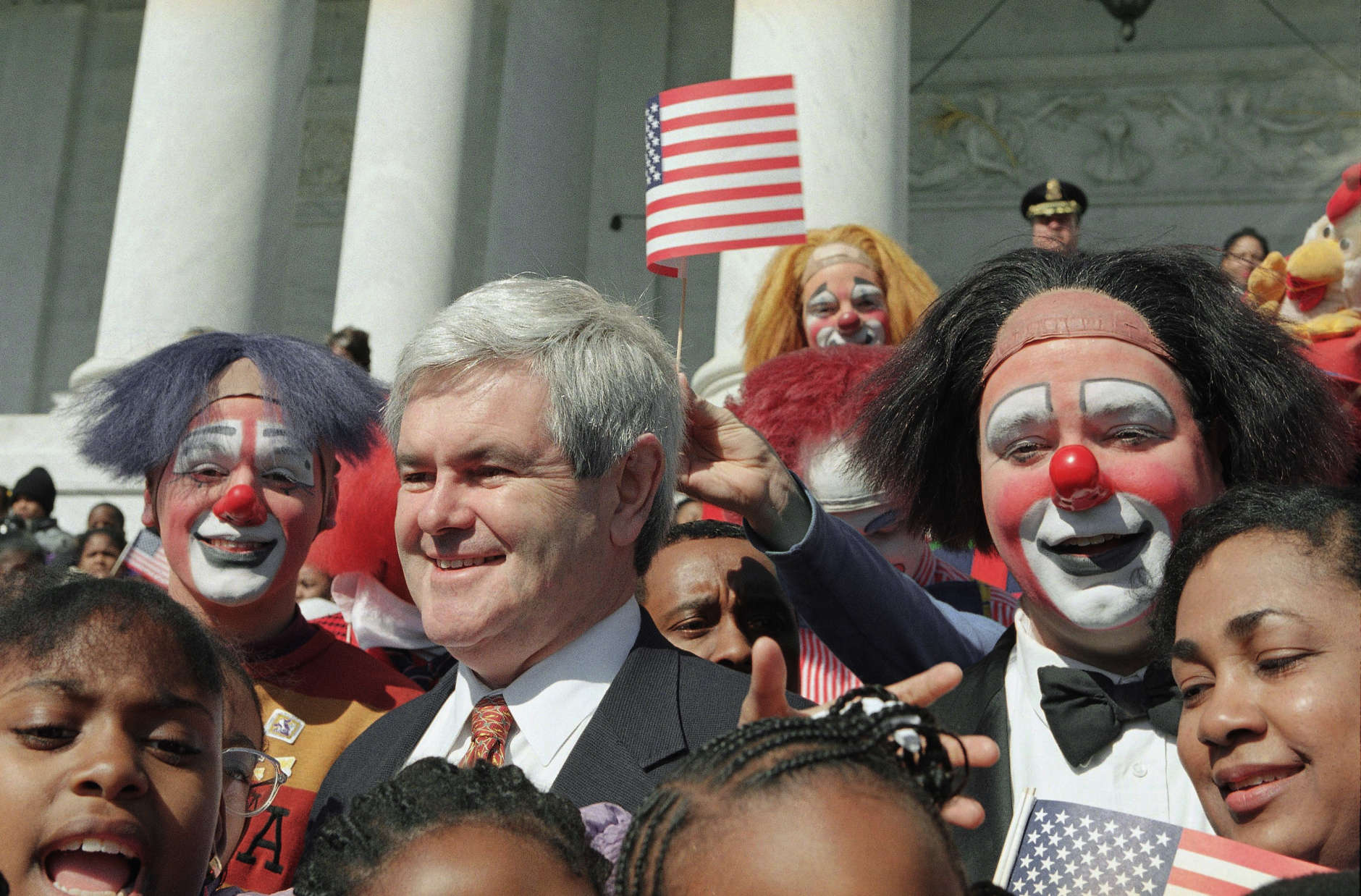 "An American flag is held over the head of House Speaker Newt Gingrich of Ga., during a Capitol Hill performance of the Ringling Brothers and Barnum and bailey circus, Wednesday, April 5, 1995 in Washington. The circus played Capitol Hill to mark its 125th anniversary and the final week to House votes on the Republicans ""Contract with America."" (AP Photo/Joe Marquette)"