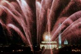 Fireworks cascade over the Lincoln Memorial, Washington Monument and the Capitol Saturday Jan. 18, 1997 during the inaugural fireworks display. Nine sites around Washington set off fireworks in honor of President Clinton's inauguration. (AP Photo/Mark Wilson)