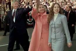 President Clinton, Mrs. Clinton and daughter Chelsea wave as they walk down Pennsylvania Avenue Monday Jan. 20, 1997 to start the presidential inaugural parade. (AP Photo/Greg Gibson)