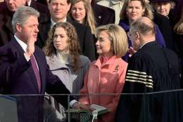 Supreme Court Chief Justice William Rehnquist administers the presidential oath to President Clinton as first lady Hillary Rodham Clinton and daughter Chelsea look on, Monday Jan. 20, 1997 on Capitol Hill. Vice President and Mrs. Gore look on behind the first family. (AP Photo/Doug Mills)