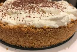Banoffee pie is made using crumbled digestive biscuits and butter for the base. Bananas, sticky toffee and whipped cream are layered on top. (WTOP/Rachel Nania)