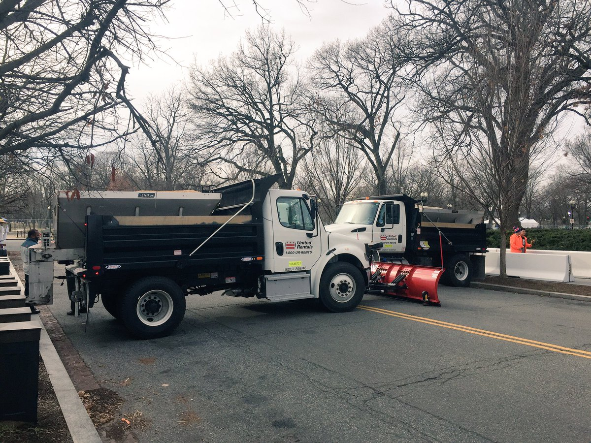 Plow trucks full of sand are being used to secure Thursday's event at the Lincoln Memorial. (WTOP/Mike Murillo)