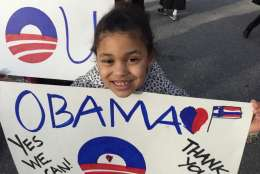 Londyn, an 8-year-old from Rockville, attends a small gathering at 15th/Pennslyvania Avenue in NW to say goodbye to President Barack Obama. (WTOP/Kristi King)