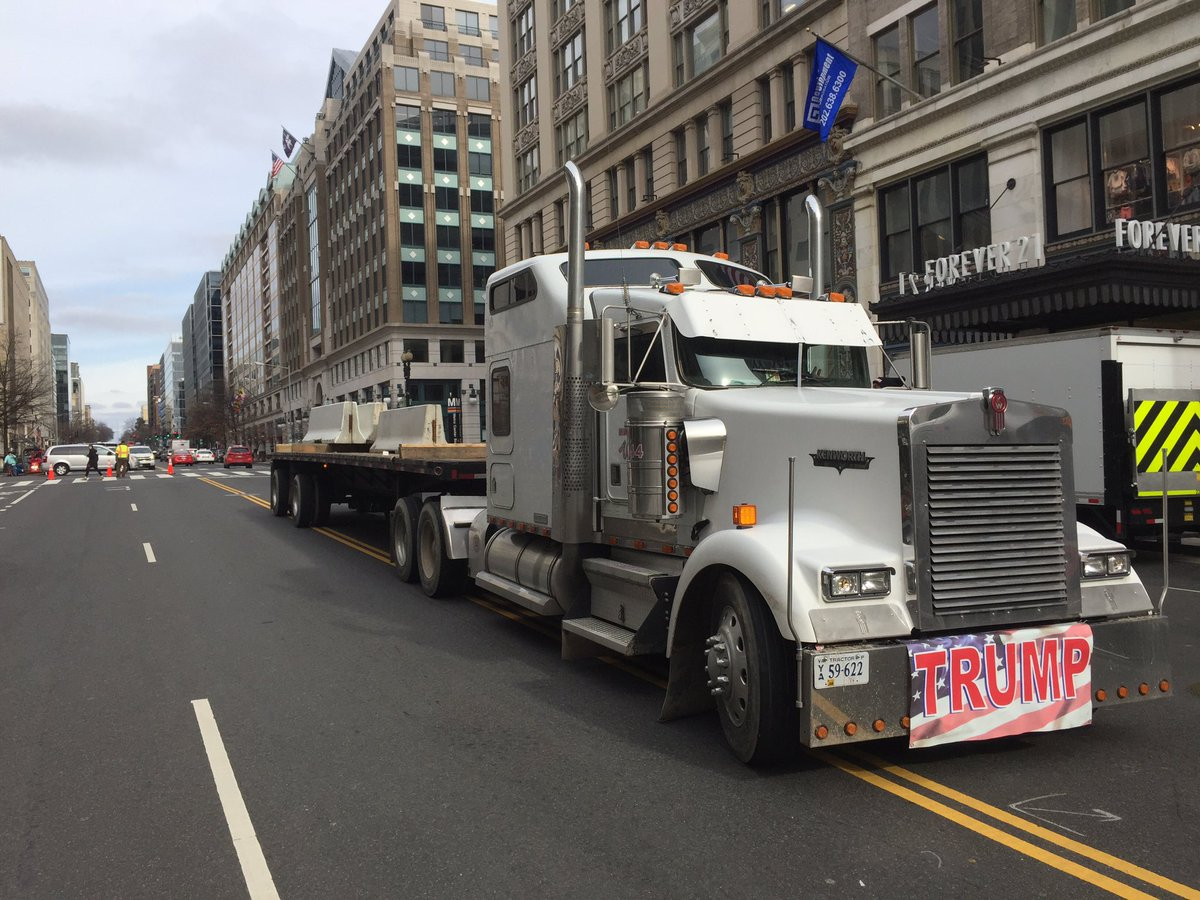 Police escorts are getting trucks with concrete barriers around town. (WTOP/Kristi King)