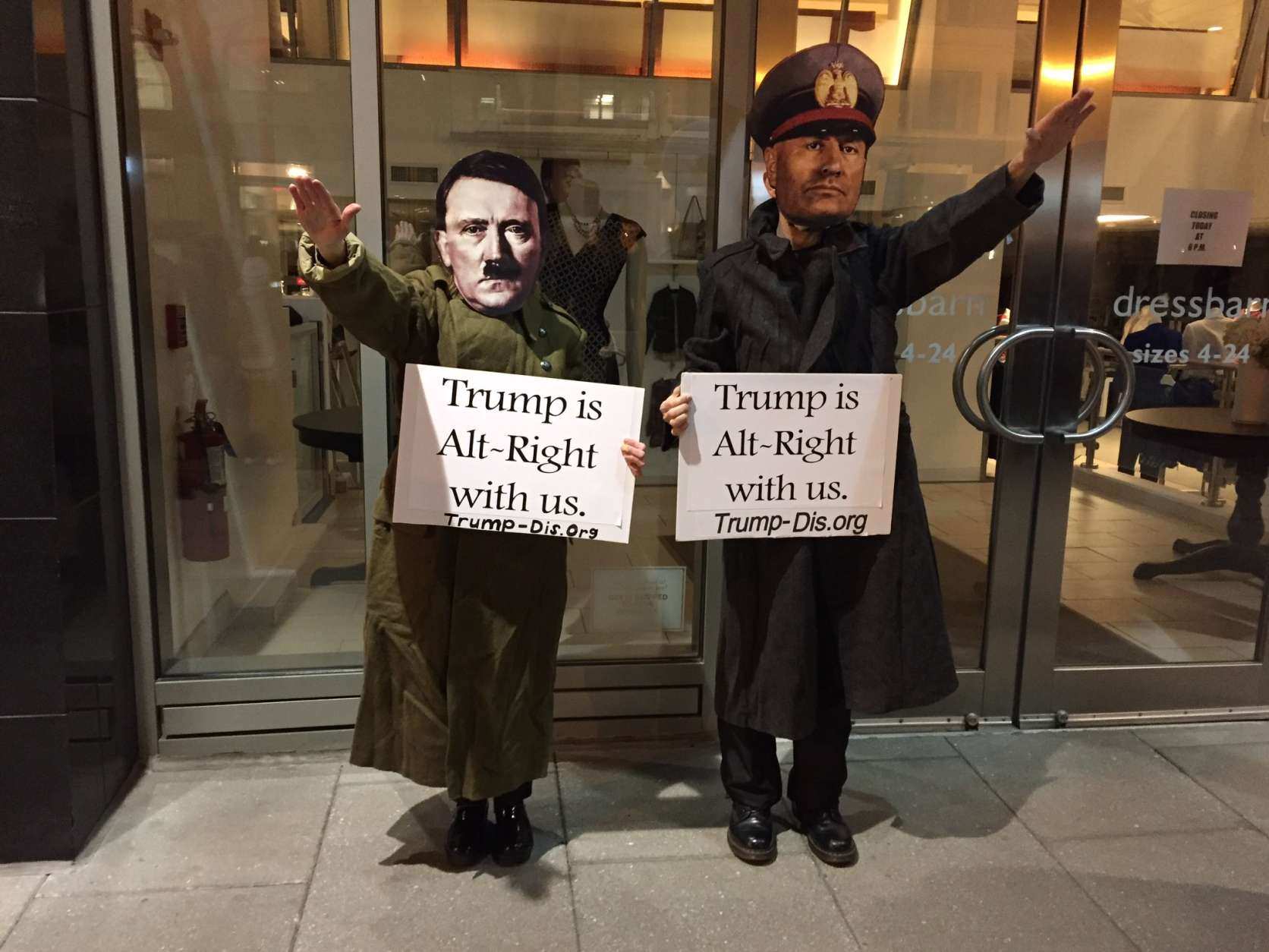 Costumed bystanders stood near the National Press Club, the site of the DeploraBall. (WTOP/Michelle Basch)