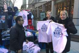 Women's March on Washington participants get gear ahead of the event, which is set for Saturday, Jan. 21, 2017. (WTOP/Kristi King)