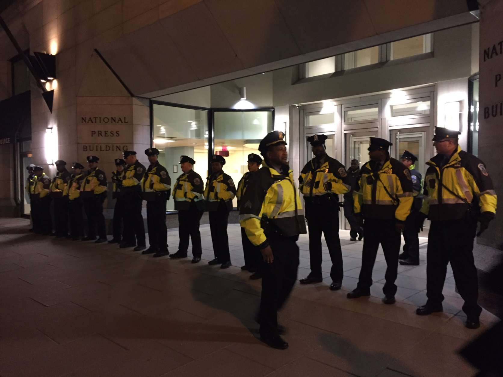A large police presence awaited protesters outside the National Press Club, site of Thursday night's DeploraBall. (WTOP/Michelle Basch)