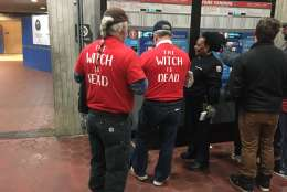 """These brothers from New York say they are glad Clinton policies are dead — like businessman Trump. The front of their shirts has the phrase, """"Donald Trumps Hillary."""" The back reads, """"The witch is dead."""" (WTOP/Max Smith)"""