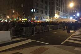 The line at 12th and E streets are long, but not unmanageable early Friday morning. (WTOP/Dennis Foley)