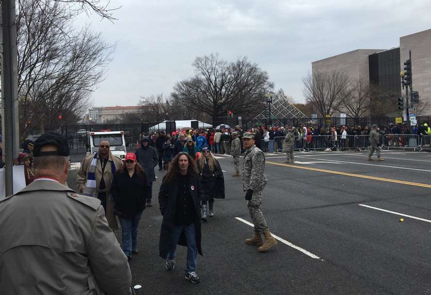 Some people leave the National Mall after Donald Trump is sworn in. (WTOP/Max Smith)