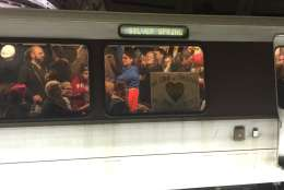Participants for the Women's March on Washington pack a Red Line train on Saturday, Jan. 21, 2017. Metro officials said ridership reached a record 1 million. (WTOP/Max Smith)