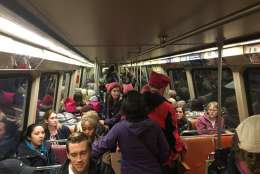 A sea of pink hat-wearing people ride the train toward the Women's March on Washington. Trains began to fill up at Union Station around 8:30 a.m. Saturday, Jan. 21, 2017, the day of the march. (WTOP/Max Smith)