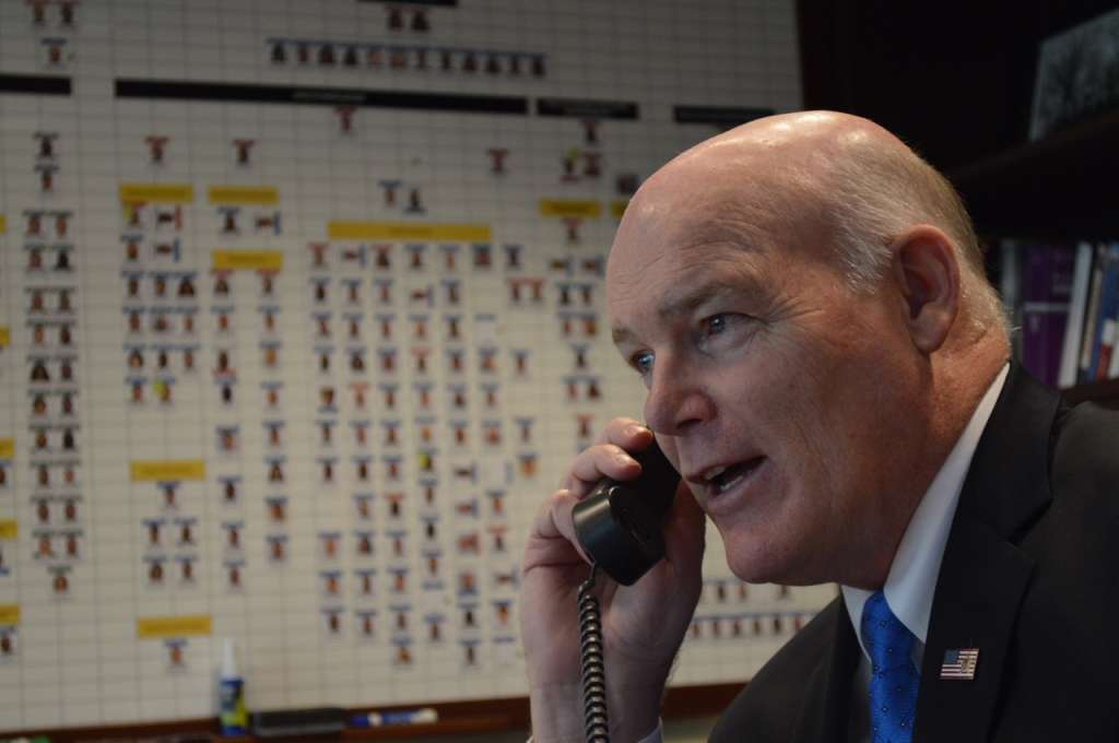 Clancy works phones checking on details as inauguration approaches. (WTOP/JJ Green)