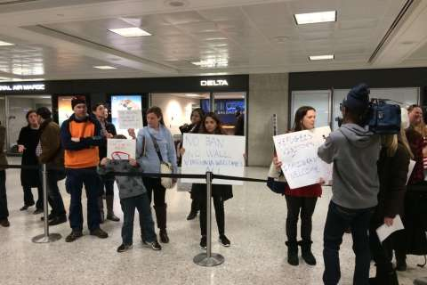 Federal judge bars US from removing legal residents detained at Dulles