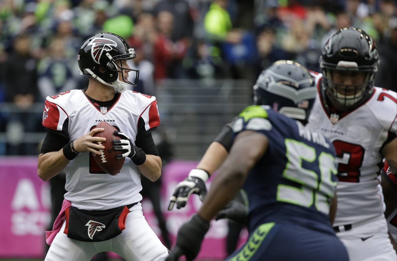 Atlanta Falcons quarterback Matt Ryan looks to pass against the Seattle Seahawks in the first half of an NFL football game, Sunday, Oct. 16, 2016, in Seattle. (AP Photo/Elaine Thompson)
