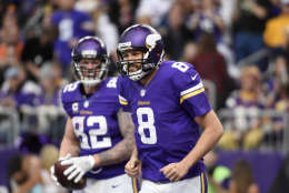 MINNEAPOLIS, MN - JANUARY 1: Sam Bradford #8 and Kyle Rudolph #82 of the Minnesota Vikings celebrate after scoring a touchdown in the first half of the game against the Chicago Bears on January 1, 2017 at US Bank Stadium in Minneapolis, Minnesota. (Photo by Hannah Foslien/Getty Images)