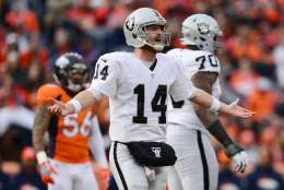 DENVER, CO - JANUARY 1:  Quarterback Matt McGloin #14 of the Oakland Raiders with his arms outstretched in the first quarter of the game against the Denver Broncos at Sports Authority Field at Mile High on January 1, 2017 in Denver, Colorado. (Photo by Dustin Bradford/Getty Images)
