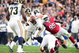 LOS ANGELES, CA - JANUARY 01:  Jared Goff #16 of the Los Angeles Rams gets sacked by Rodney Gunter #95 of the Arizona Cardinals during the fourth quarter of a 44-6 Rams loss at Los Angeles Memorial Coliseum on January 1, 2017 in Los Angeles, California.  (Photo by Harry How/Getty Images)