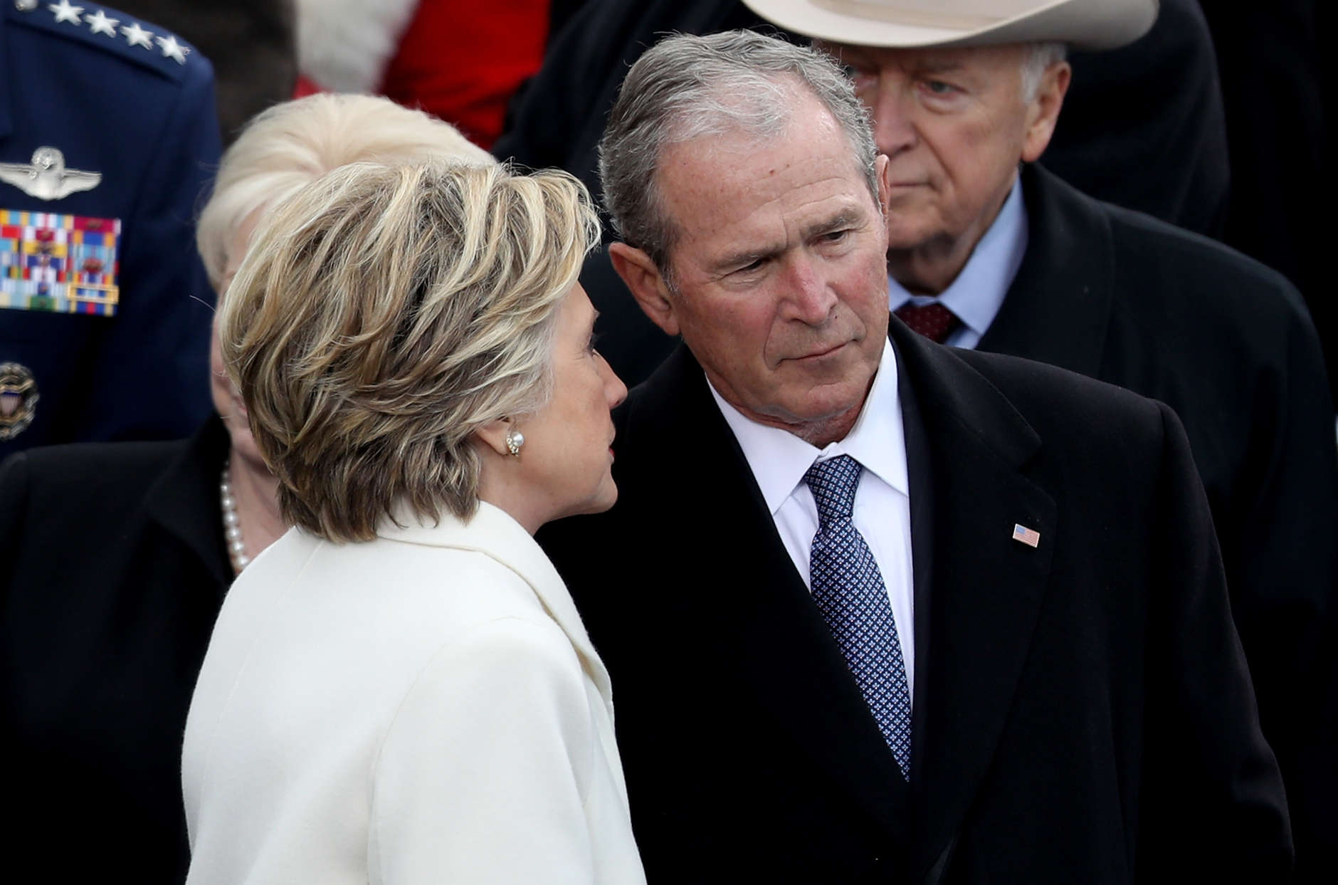 WASHINGTON, DC - JANUARY 20: Former Democratic presidential nominee Hillary Clinton whispers to former President George W. Bush  on the West Front of the U.S. Capitol on January 20, 2017 in Washington, DC. In today's inauguration ceremony Donald J. Trump becomes the 45th president of the United States.  (Photo by Joe Raedle/Getty Images)