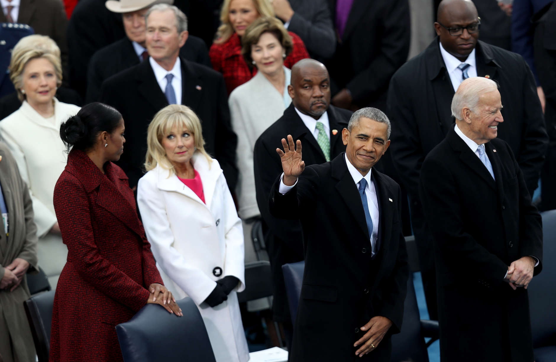 WASHINGTON, DC - JANUARY 20:  President Barack Obama waves to the crowd as Michelle Obama (L) and Jill Biden stand by on the West Front of the U.S. Capitol on January 20, 2017 in Washington, DC. In today's inauguration ceremony Donald J. Trump becomes the 45th president of the United States.  (Photo by Joe Raedle/Getty Images)