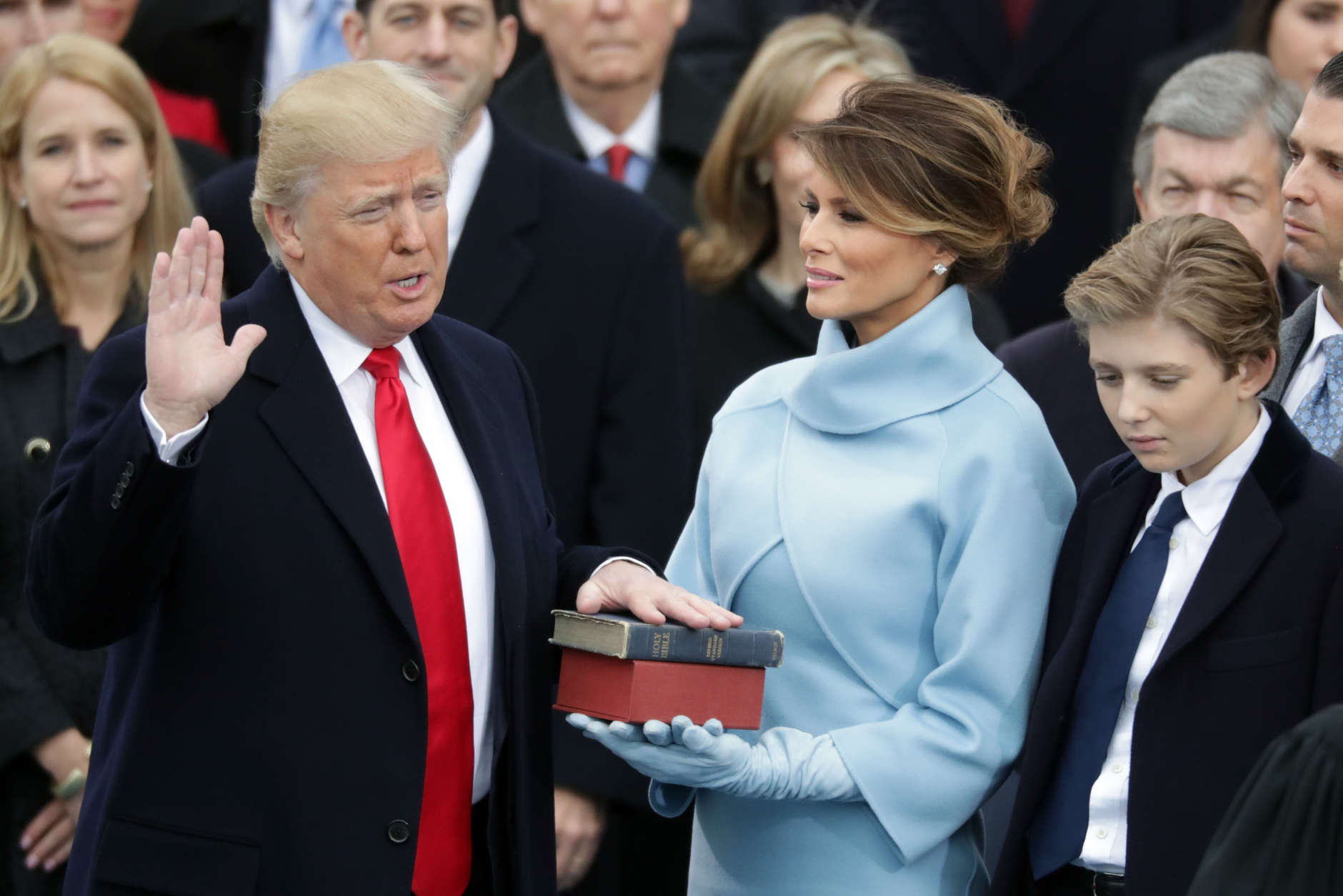 WASHINGTON, DC - JANUARY 20:  (L-R) U.S. President Donald Trump takes the oath of office as his wife Melania Trump holds the bible and his son Barron Trump looks on, on the West Front of the U.S. Capitol on January 20, 2017 in Washington, DC. In today's inauguration ceremony Donald J. Trump becomes the 45th president of the United States.  (Photo by Chip Somodevilla/Getty Images)
