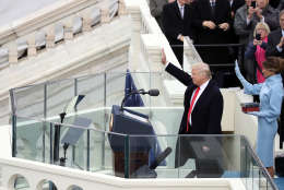 WASHINGTON, DC - JANUARY 20:  U.S. President Donald Trump and his wife Melania Trump wave after he took the oath of office on the West Front of the U.S. Capitol on January 20, 2017 in Washington, DC. In today's inauguration ceremony Donald J. Trump becomes the 45th president of the United States.  (Photo by Drew Angerer/Getty Images)