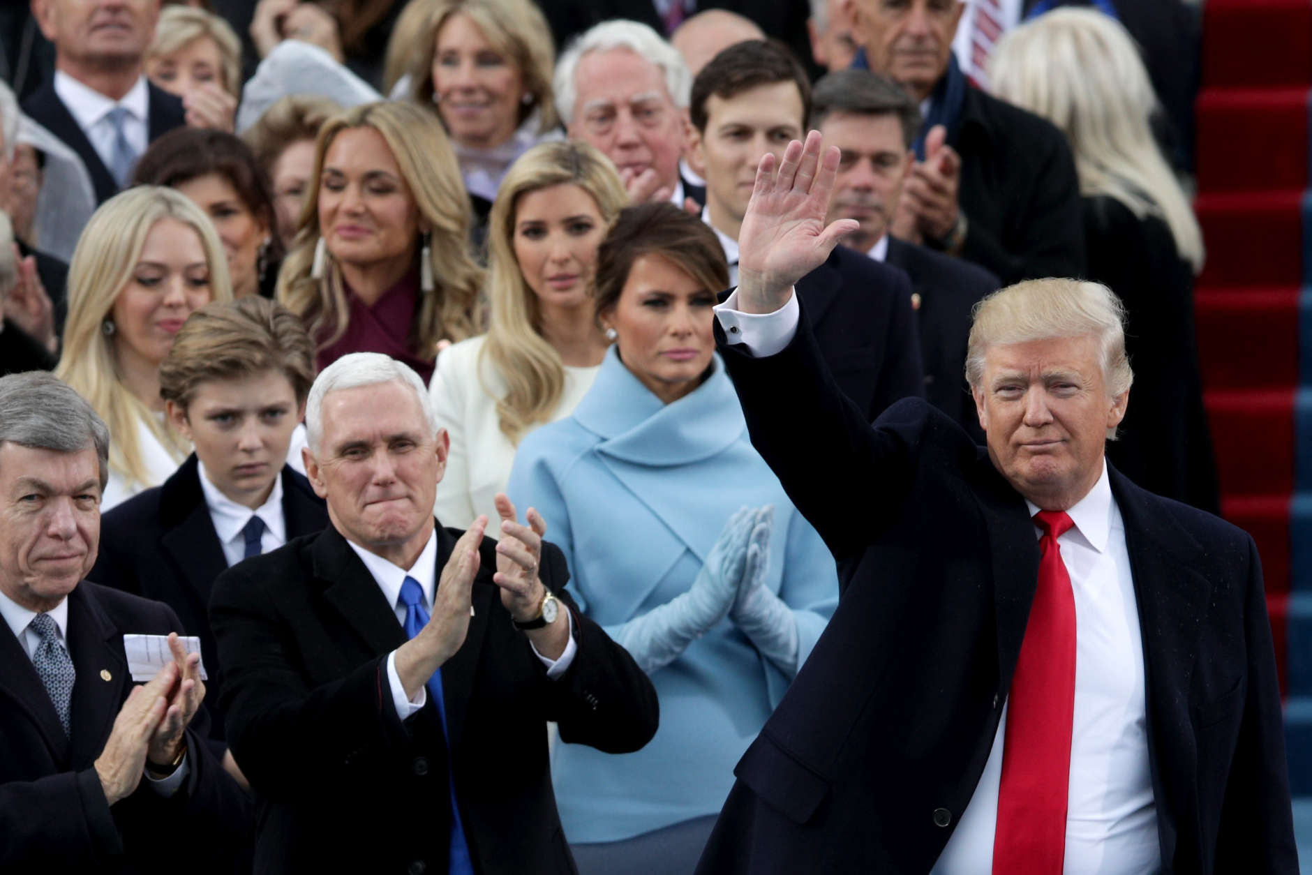 WASHINGTON, DC - JANUARY 20:  President Donald Trump waves as Vice President Mike Pence and First Lady Melania Trump applaud on the West Front of the U.S. Capitol on January 20, 2017 in Washington, DC. In today's inauguration ceremony Donald J. Trump becomes the 45th president of the United States.  (Photo by Alex Wong/Getty Images)