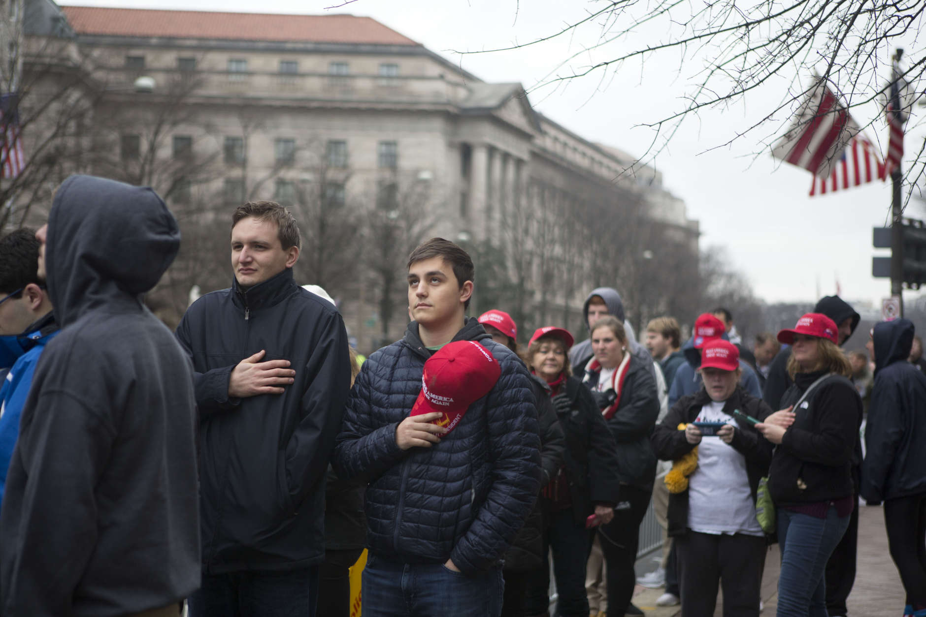 WASHINGTON, DC - JANUARY 20: Supporters stand along Pennsylvania Avenue for the singing of the national anthem during the inauguration of Donald Trump on January 20, 2017 in Washington, DC. Today Trump is sworn in as the 45th president of the United States. (Photo by Jessica Kourkounis/Getty Images)