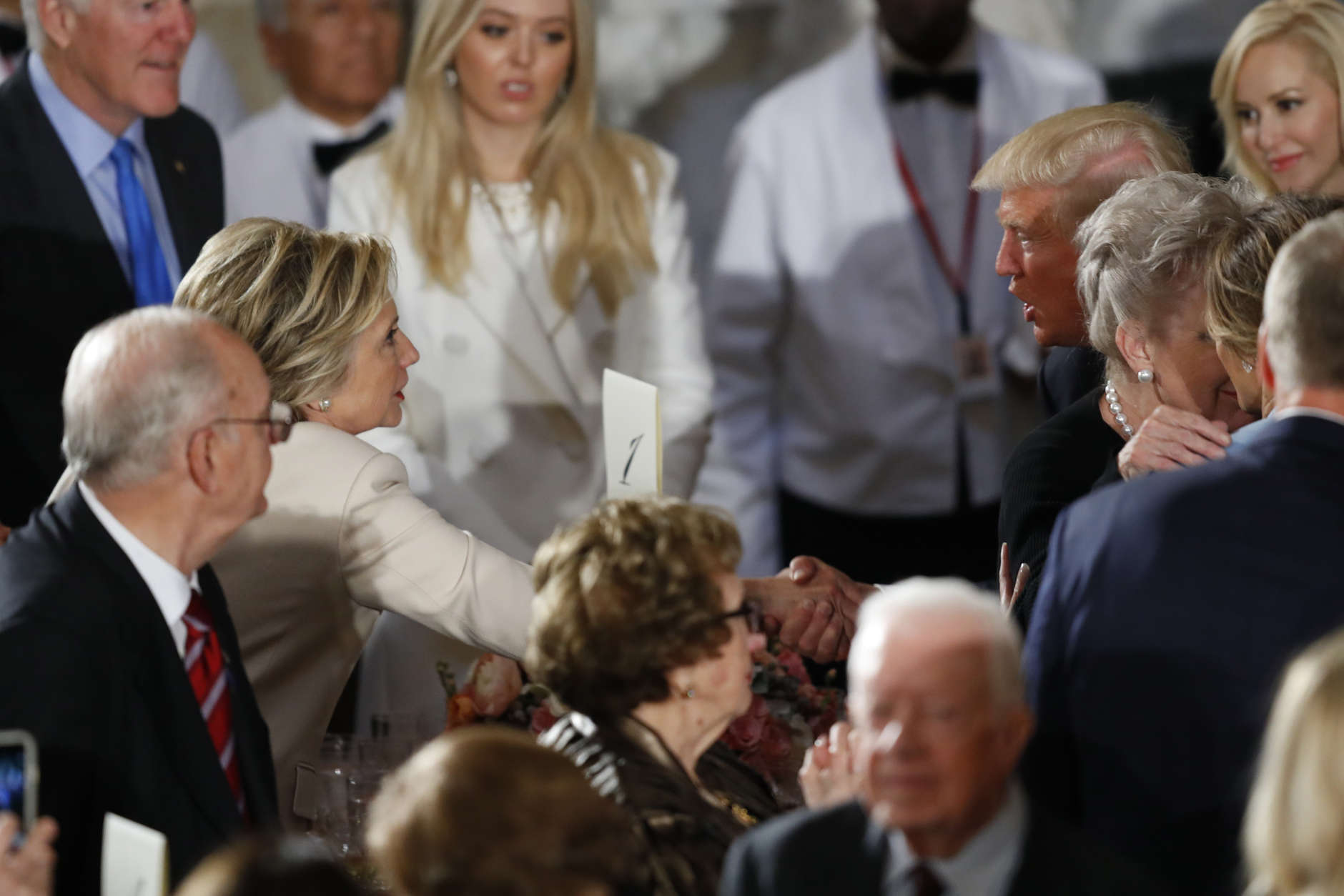 WASHINGTON, DC - JANUARY 20:  President Donald Trump greets Hillary Clinton at the Inaugural Luncheon in the US Capitol January 20, 2017 in Washington, DC. President Trump will attend the luncheon along with other dignitaries after being sworn in as the 45th President of the United States. (Photo by Aaron P. Bernstein/Getty Images)