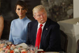 WASHINGTON, DC - JANUARY 20:  President Donald Trump and first lady Melania Trump attend the Inaugural Luncheon in the US Capitol January 20, 2017 in Washington, DC. President Trump is attending the luncheon along with other dignitaries after being sworn in as the 45th President of the United States. (Photo by Aaron P. Bernstein/Getty Images)